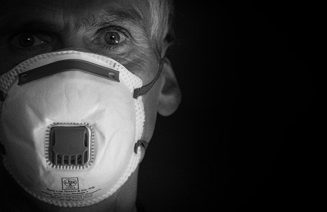 A close up of a person wearing a mask