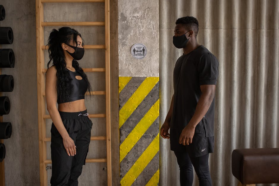 A man and a woman standing in front of a door